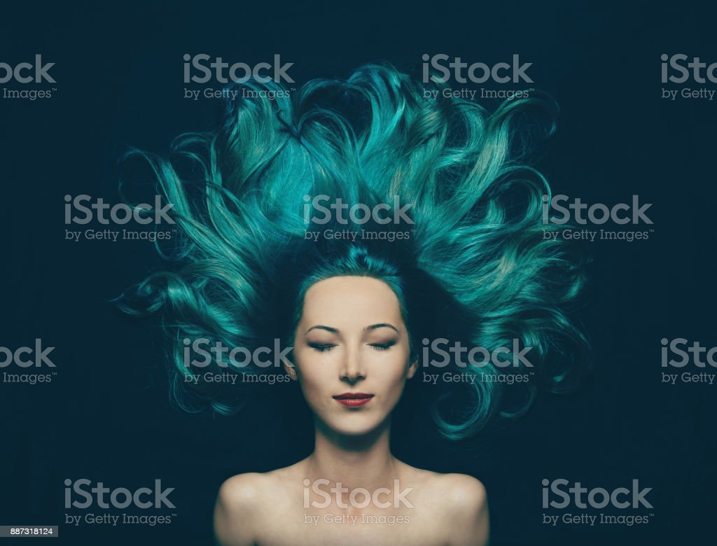 Beautiful girl with long hair of turquoise color stock photo