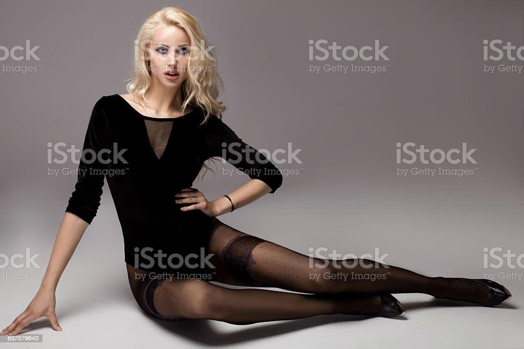 Beautiful girl with long legs. - Photo