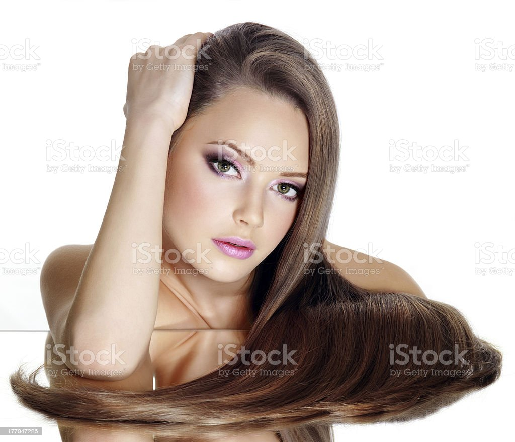 Beautiful girl with long straight hair royalty-free stock photo