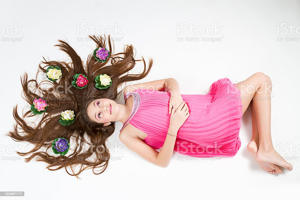 Beautiful girl with loto flowers on hairs stock photo