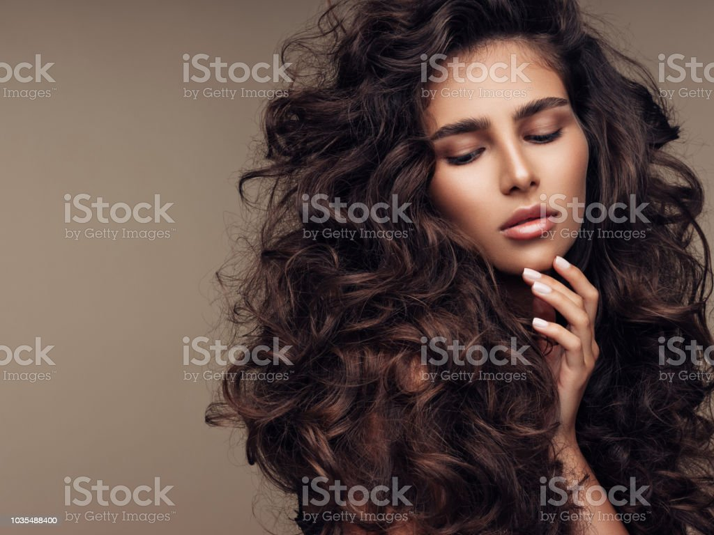 Beautiful girl with lush curly hairstyle stock photo