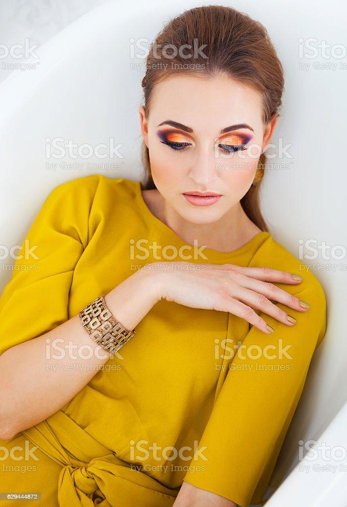 Beautiful girl with make up wearing long yellow dress - foto de acervo