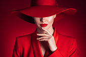 istock Beautiful girl with make-up wearing red jacket and hat 1224236834