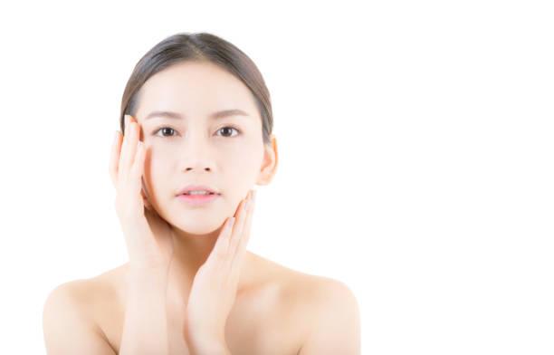 美しい少女メイク、女、肌ケアの概念/魅力的なアジアの女の子 smilling 白い背景で隔離の顔に。 - beauty and health ストックフォトと画像