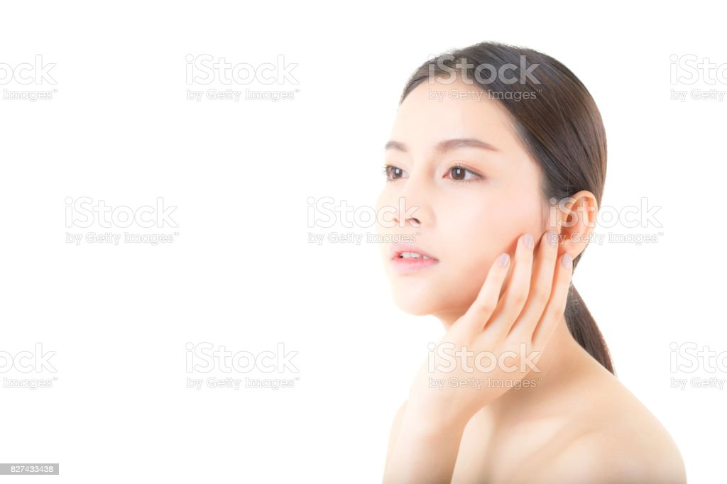Beautiful girl with makeup, woman and skin care concept / attractive asia girl smilling on face isolated on white background. stock photo