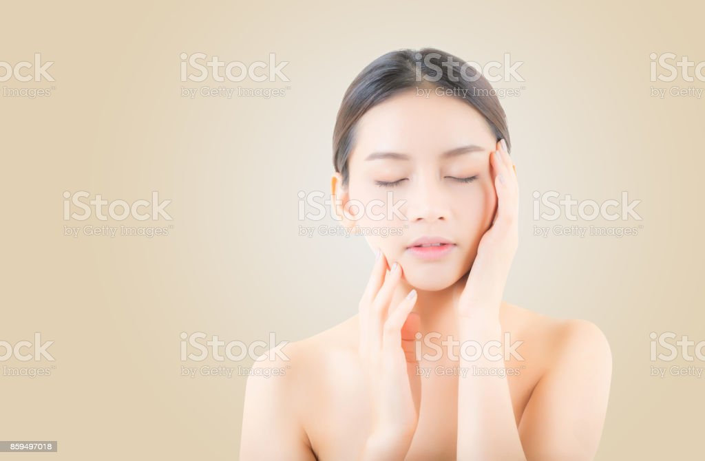 Beautiful girl with makeup, woman portrait and skin care cosmetic concept / attractive beauty asian girl on face on yellow background. stock photo