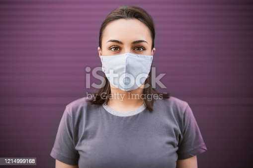 Beautiful girl with medical mask to protect her from virus. Corona virus pandemic.