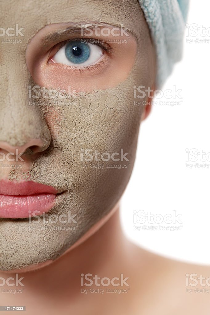 Beautiful girl with medicinal mud mask on her face stock photo