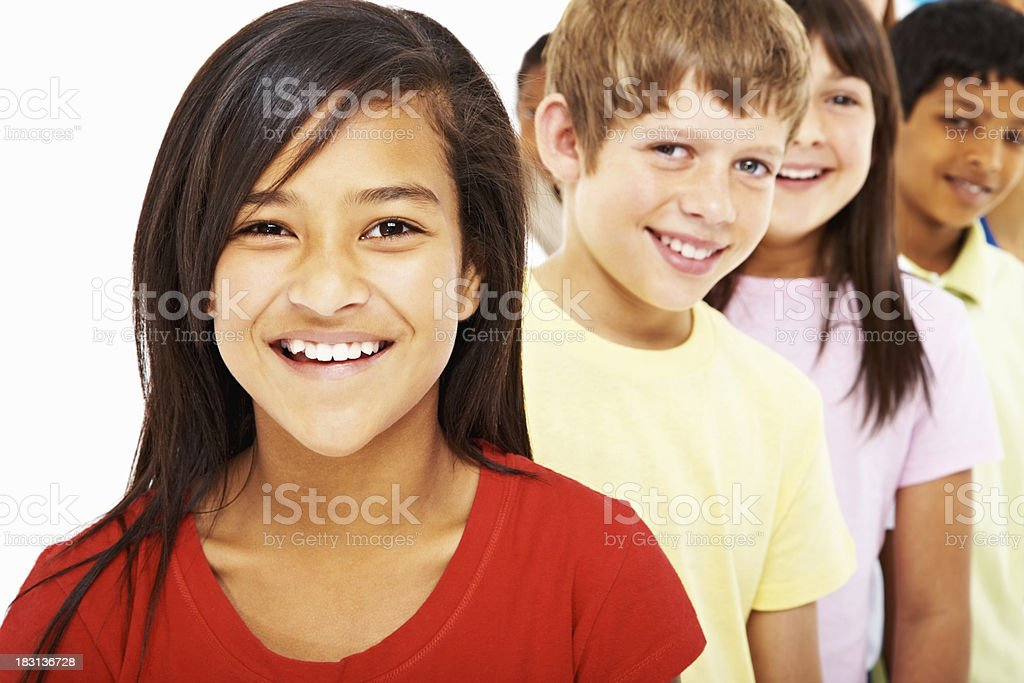 Beautiful girl with multi ethnic friends in a row smiling royalty-free stock photo