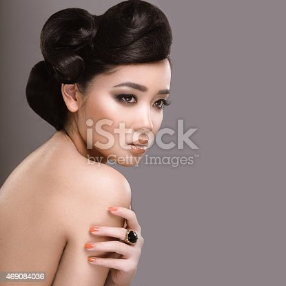 istock Beautiful girl with oriental type evening hair and makeup. 469084036