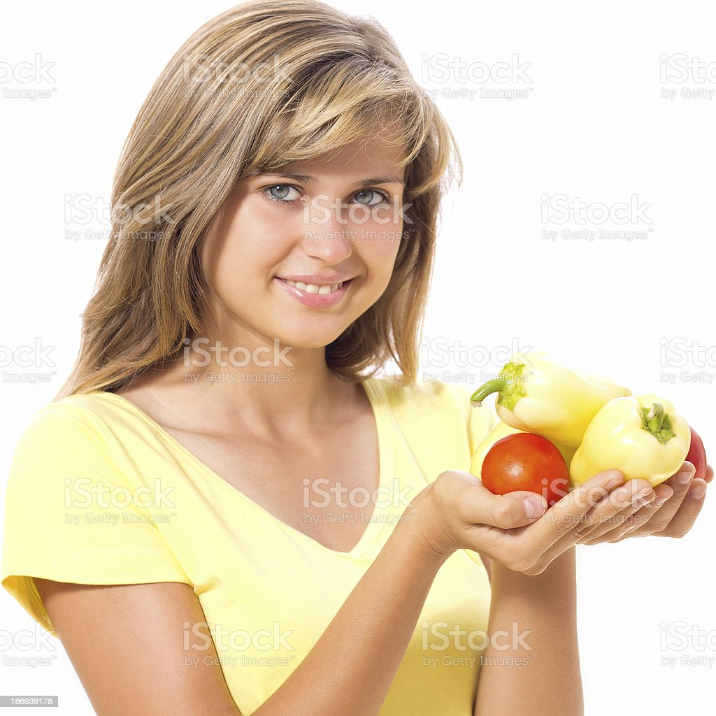 beautiful girl with pepper and tomatoes in hand royalty-free stock photo