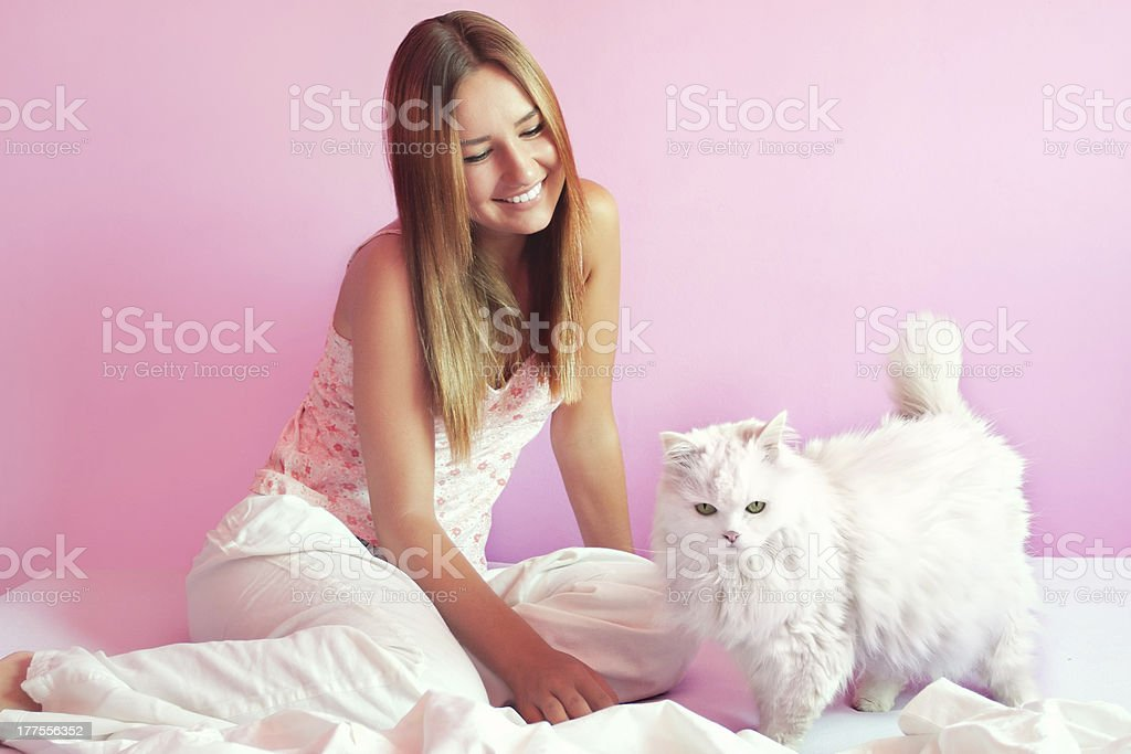 Beautiful girl with persian cat stock photo