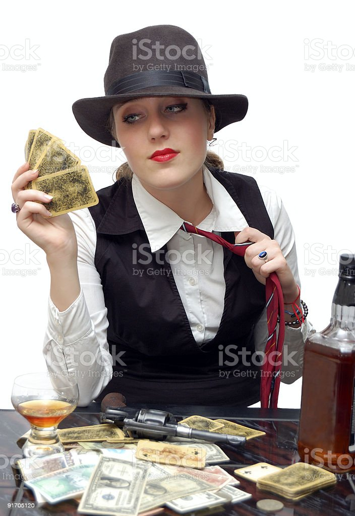 Beautiful girl with playing cards and gun royalty-free stock photo