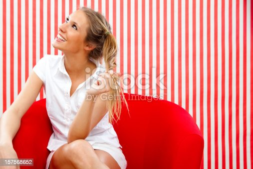 istock Beautiful girl with ponytail red portrait 157568652