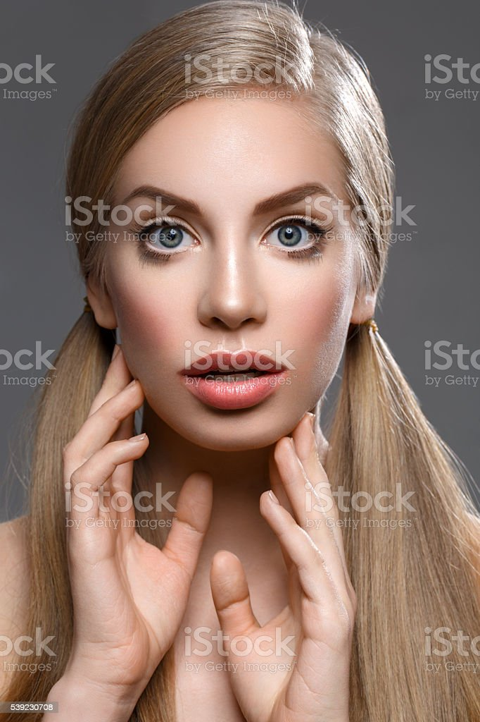 Beautiful girl with ponytails royalty-free stock photo
