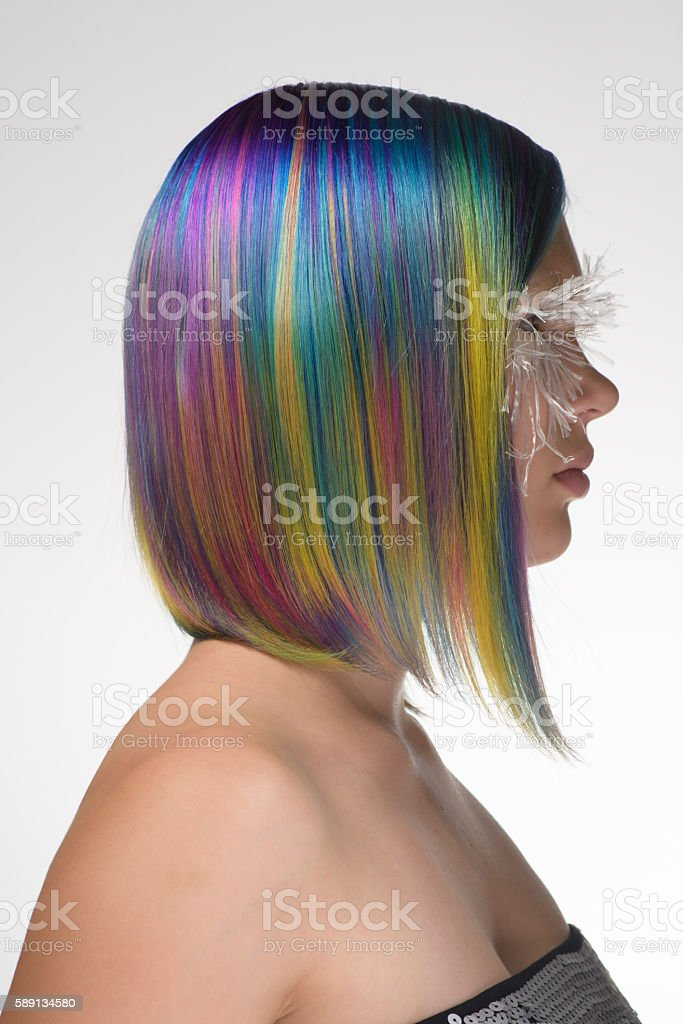 beautiful girl with professional hair colouring and creative make up stock photo