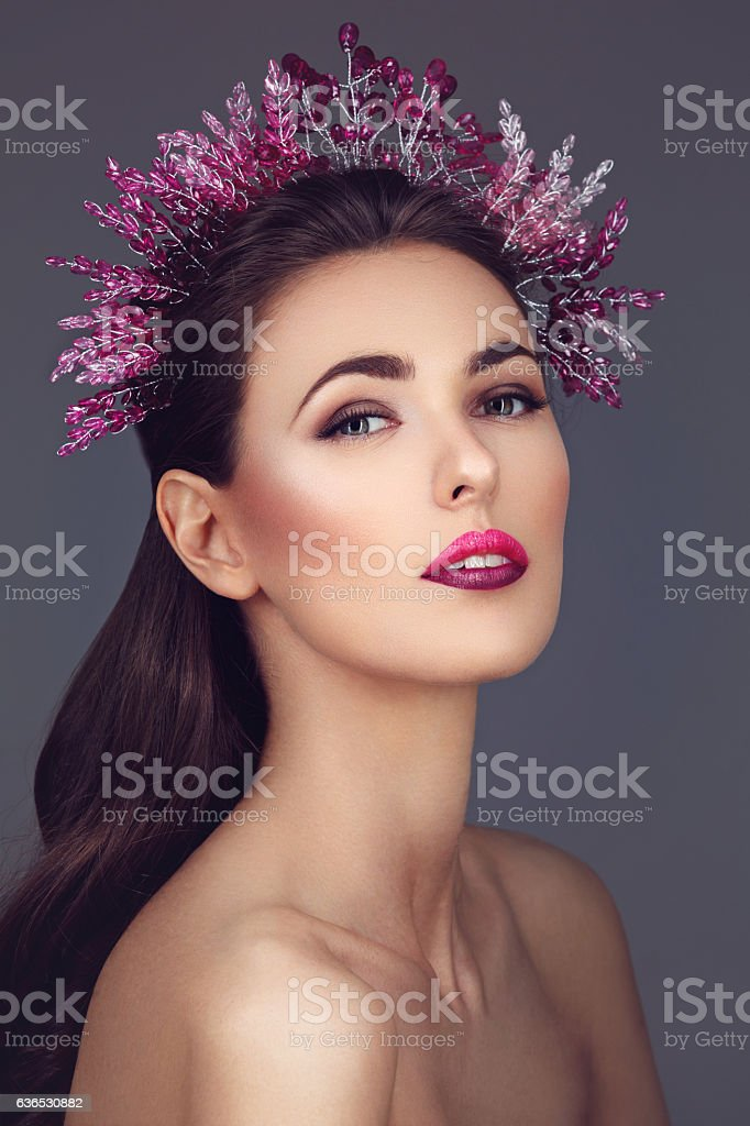 Beautiful girl with purple makeup and head piece stock photo