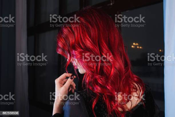 Beautiful Girl With Red Hair And Natural Makeup And Pale Skin A Woman In A Black Retro Dress Model Posing In Studio The Unusual Appearance Insidious Wicked Witch Woman Stock Photo - Download Image Now