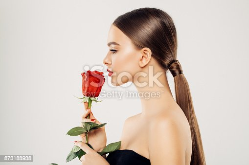 Beautiful girl with red rose
