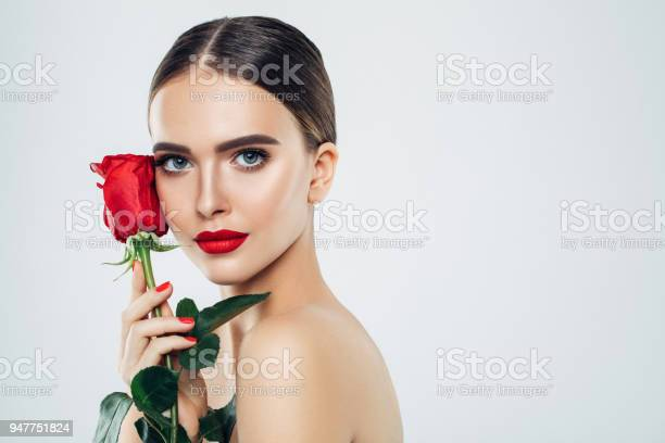 Beautiful girl with red rose picture id947751824?b=1&k=6&m=947751824&s=612x612&h=q75ao8re7tvttwbnspiikcd0biv2fvtudwcnwx87s5q=