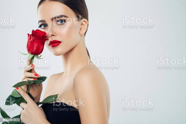 Beautiful girl with red rose picture id950484920?b=1&k=6&m=950484920&s=612x612&h=hzm  ugrdnokoitaxpoip6cnsvb4v81ekdvh lifsic=