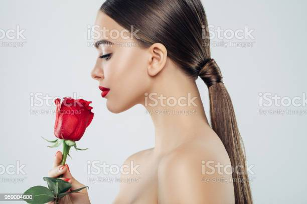 Beautiful girl with red rose picture id959004600?b=1&k=6&m=959004600&s=612x612&h=vh6hhq6 8szj3epsxyf0ricisahko4utzwlqinhfhnk=