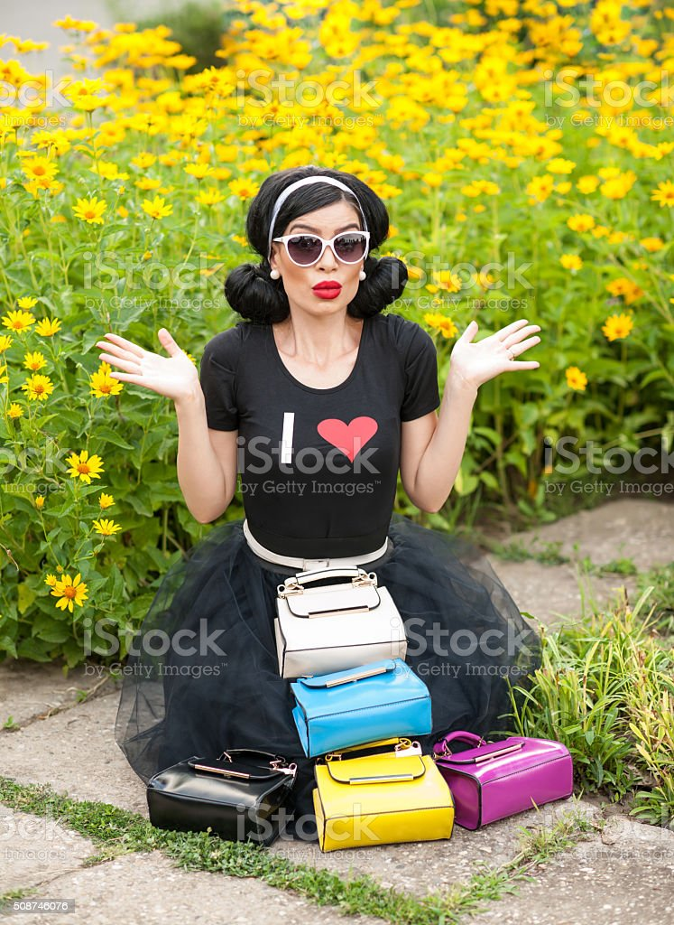Beautiful Girl With Retro Look Wearing A Black Outfit Stock Photo ... ea7ebfc61cef