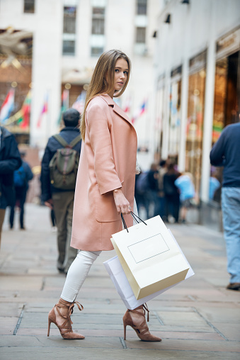 istock Beautiful girl with shopping bags going to the store 599972848