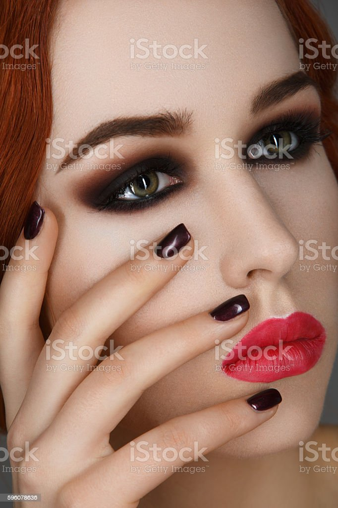 Beautiful girl with smoky eyes and red lips royalty-free stock photo