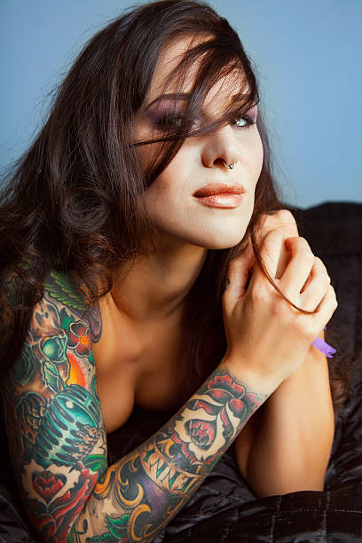 Best Beautiful Naked Tattooed Women Stock Photos, Pictures
