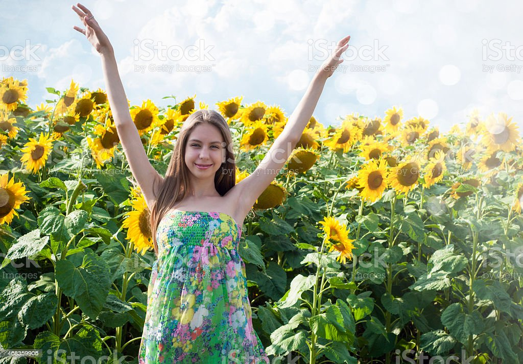 Beautiful girl with sunflower royalty-free stock photo