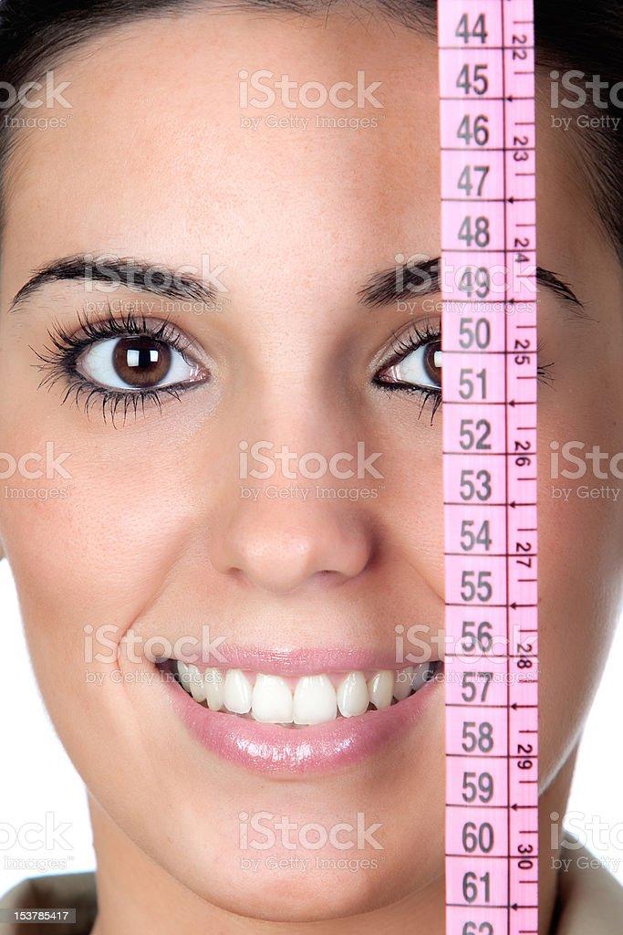 Beautiful girl with tape measure stock photo