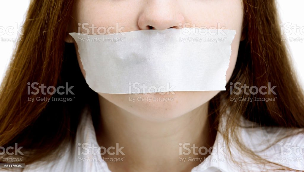 Beautiful girl with the mouth closed, the white ribbon stock photo