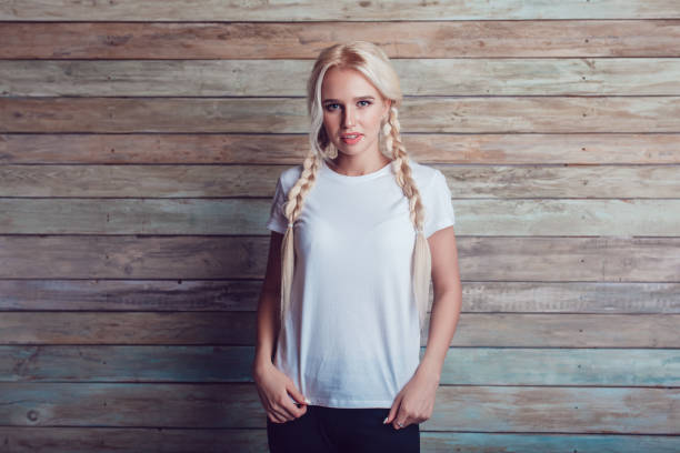 beautiful girl with two braids in a white t-shirt. mock-up. - pigtails stock photos and pictures