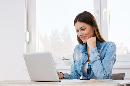 istock Beautiful girl working from her home office. 898165312
