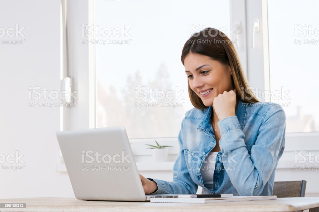 Beautiful girl working from her home office. stock photo