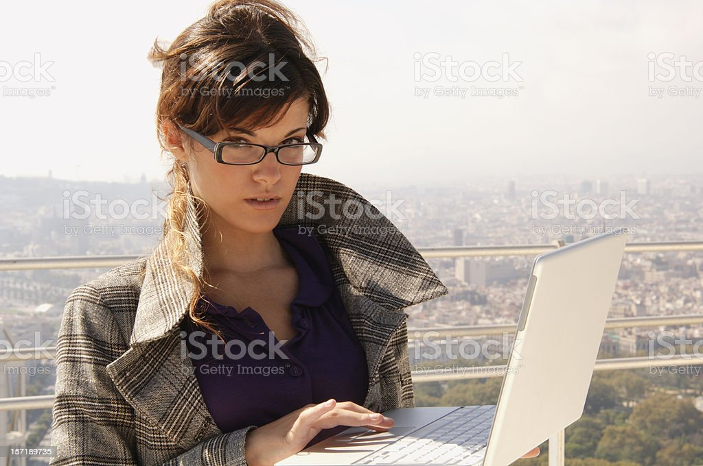 Beautiful girl working on laptop royalty-free stock photo