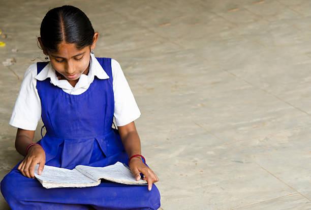 beautiful girl writing in a village school stock photo