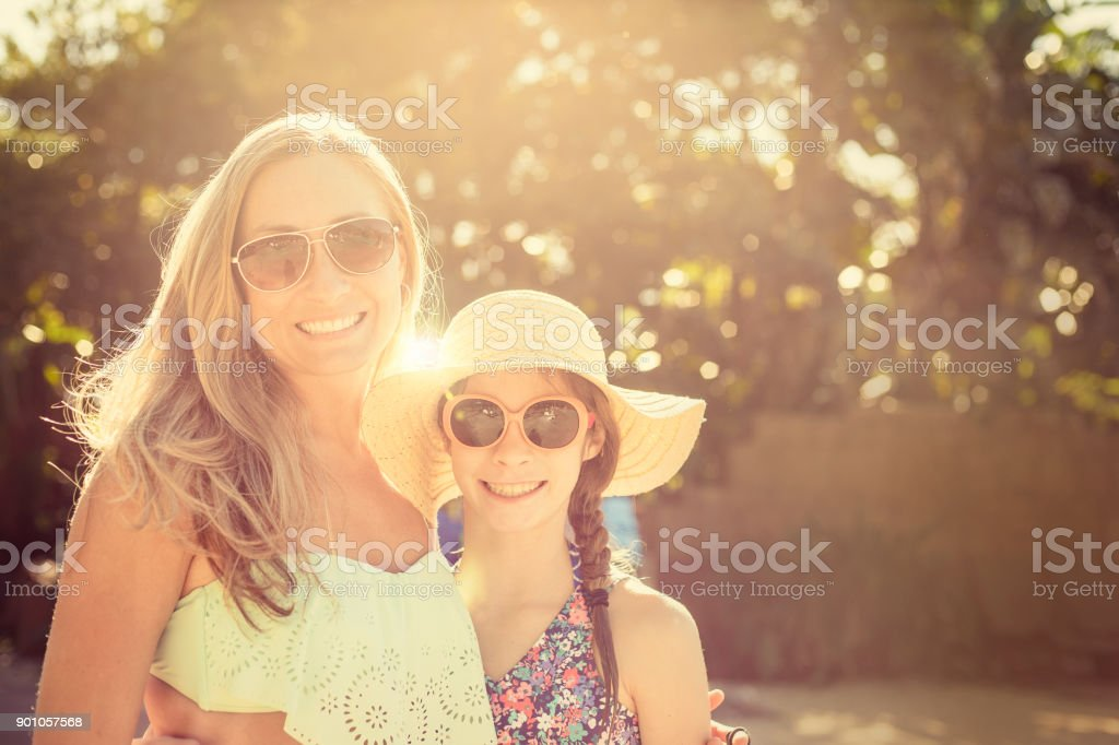Beautiful girls enjoying the sunlight outdoors together stock photo