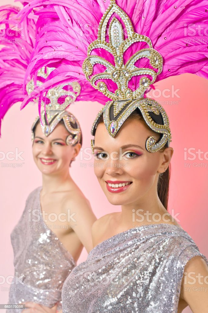 Beautiful Girls in carnival costume with pink feathers. royalty-free stock photo