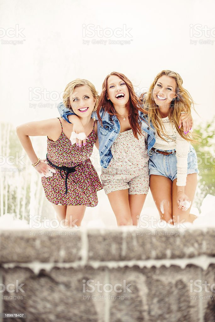 Beautiful girls playing in fountain royalty-free stock photo