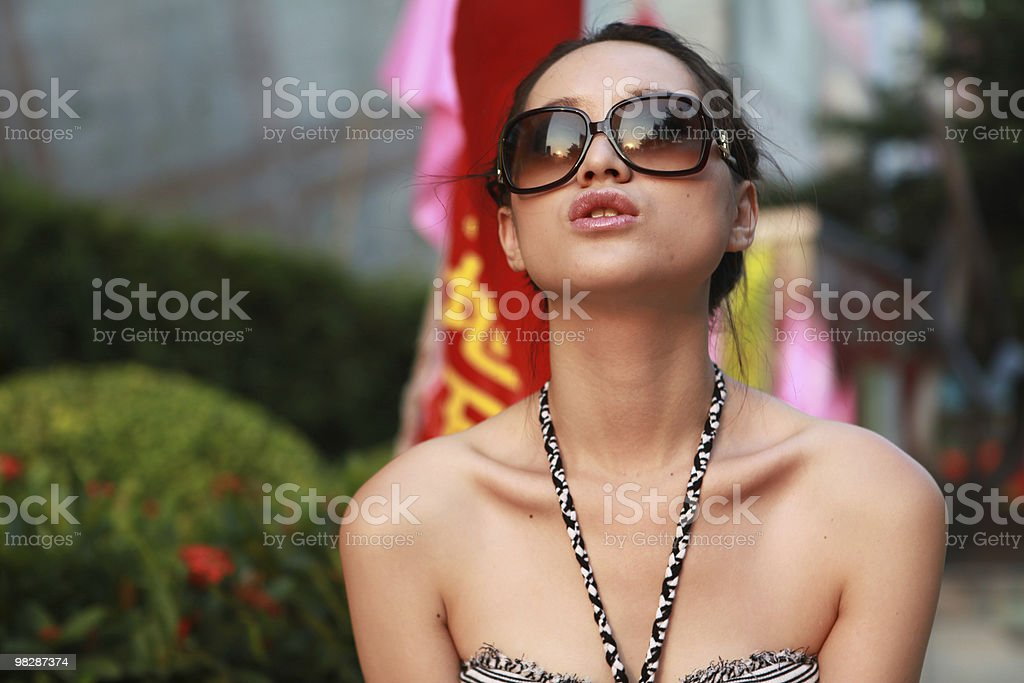 Beautiful girls wearing fashionable sunglasses royalty-free stock photo