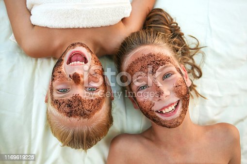 Beautiful girls with facial mask coffee scrub. Top view.