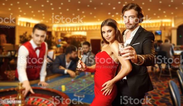 Beautiful glamour couple against the background of casino poker picture id1158016188?b=1&k=6&m=1158016188&s=612x612&h=itkb0ub9yhar yoyuwmbp9tin4mkurol3ijq u3oehw=