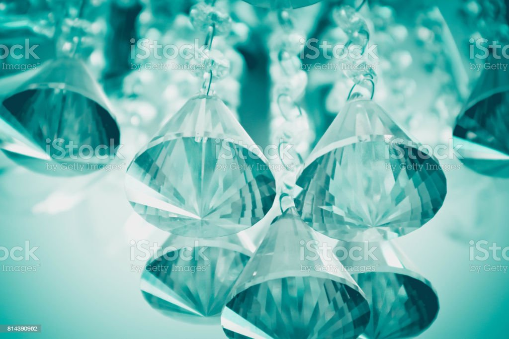 Beautiful glamour glass crystal chandelier closeup. stock photo
