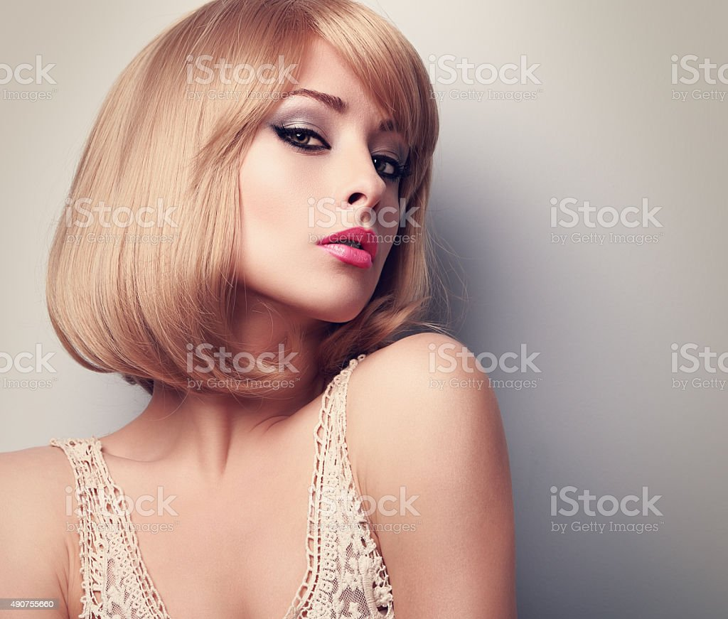 beautiful glamour makeup blond woman with short hair style clos