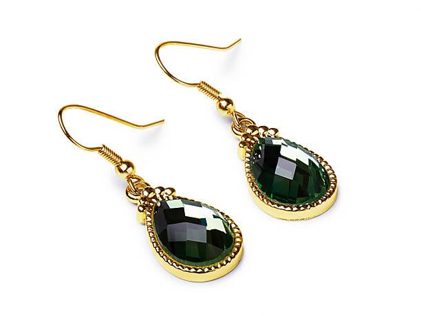 beautiful gold earrings with emeralds - ohrringe tropfen stock-fotos und bilder