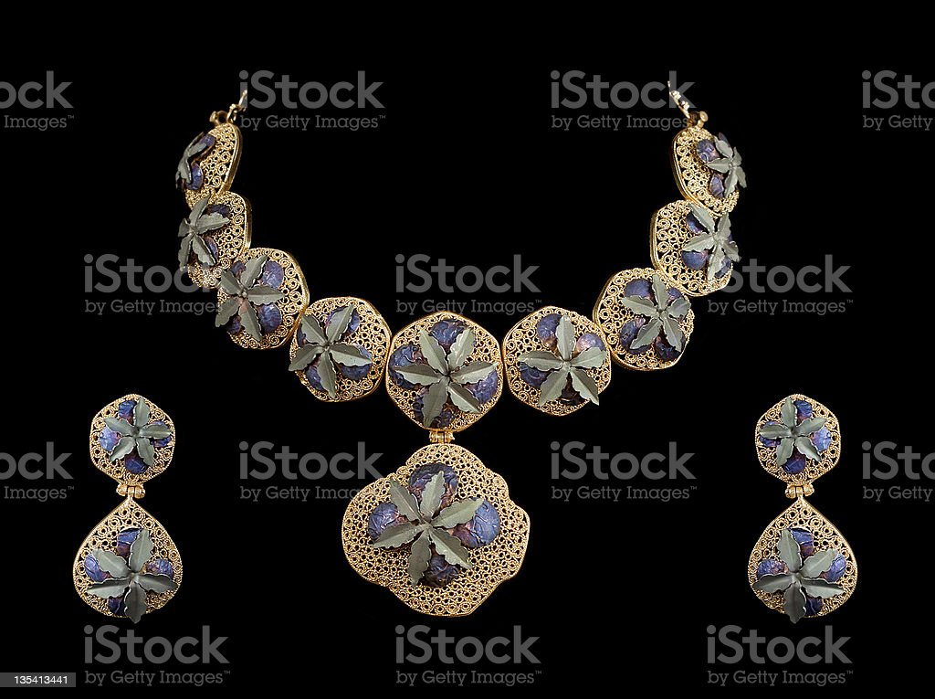 beautiful gold necklace with ear ring royalty-free stock photo