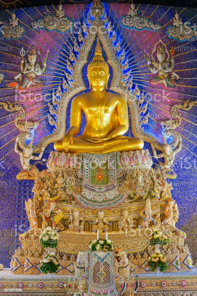 Beautiful golden Buddha image with god and goddess statue decorated on wall stock photo