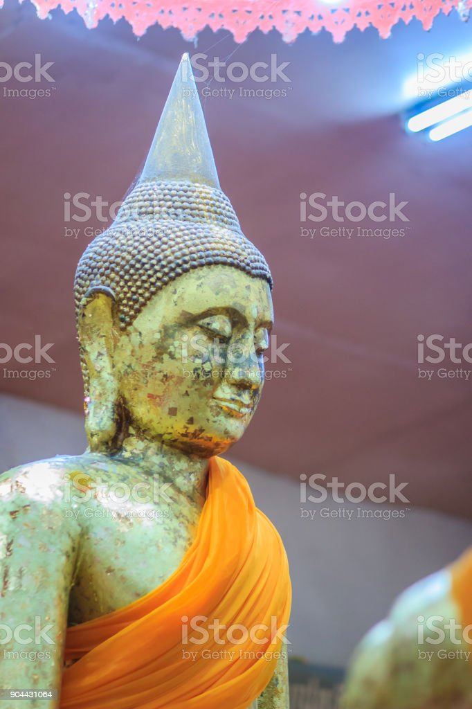 Beautiful golden Buddha statue at Wat Sothorn, Chachoengsao Thailand. stock photo